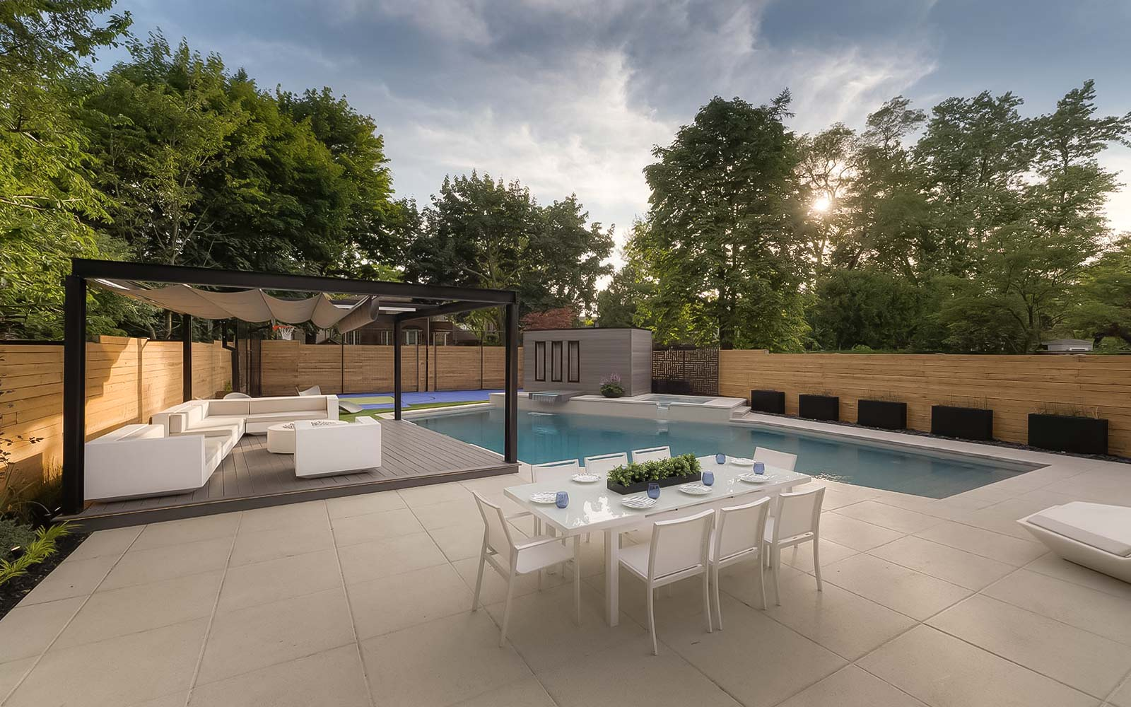 Toronto Landscaping Project Featuring Pool With Water Features, Outdoor Fireplace, Sports Court, Decking & Fencing.