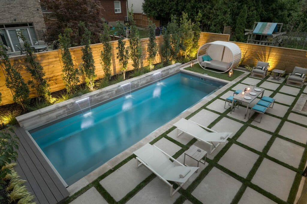 Toronto Landscaping Design Project on Joicey Blvd; Featuring Fiberglass Pool Installation, Retaining Wall, Privacy Fencing, Interlocking & TREX Decking