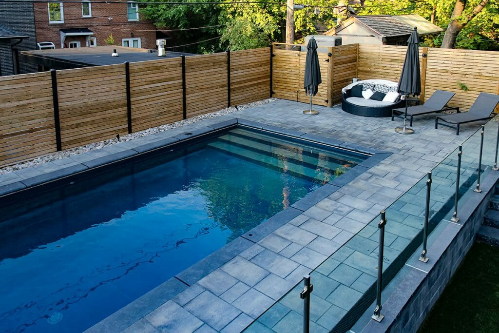 Toronto Landscaping Pool Installation Project; Featuring Stainless Steel & Glass Railings