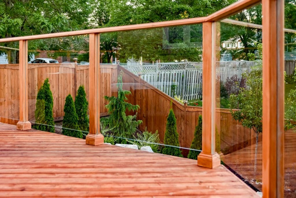 Toronto Landscaping Project; Featuring Framed Glass Railings & Cedar Decking