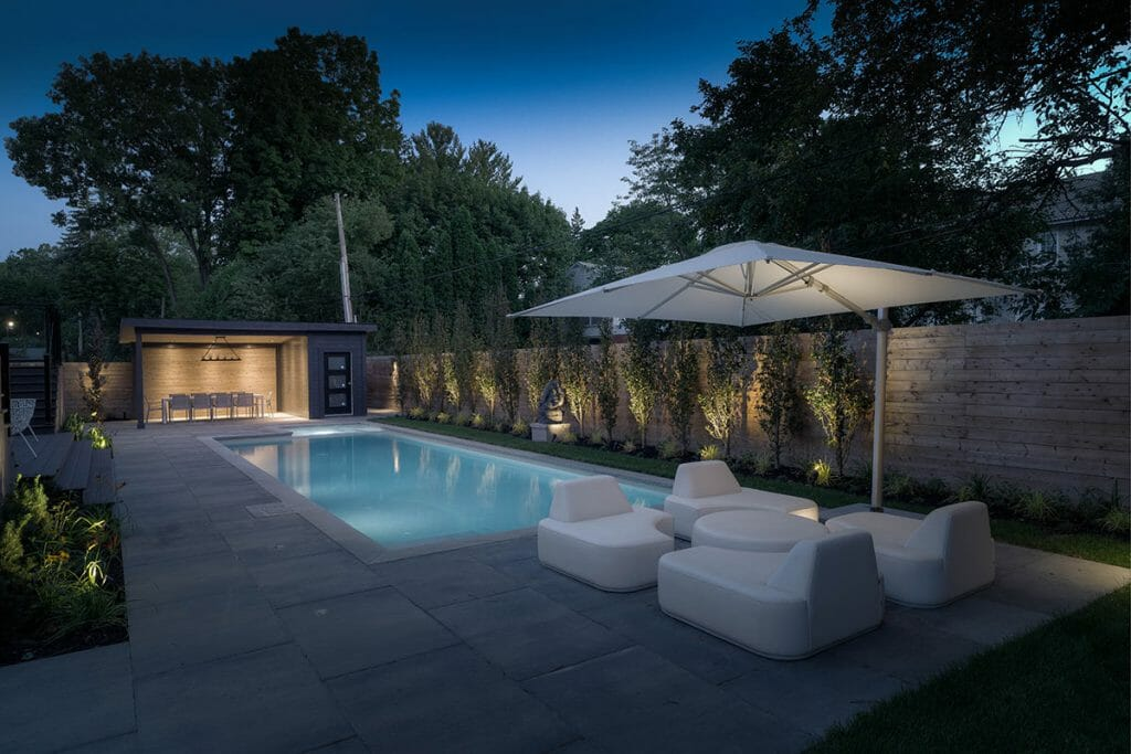 Toronto Landscaping Project; Featuring Illuminated Concrete Pool, Privacy Fence, Gazebo & Interlocking by Toronto Landscaping Company