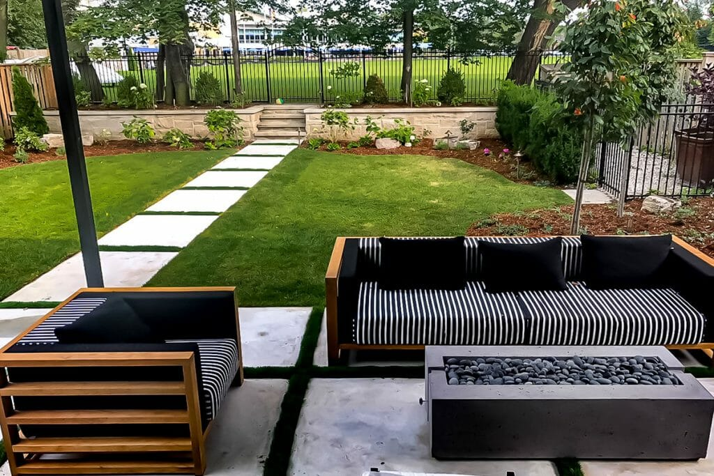 Toronto Landscaping Project; Featuring Interlocking Pathway, Retaining Wall & Outdoor Fireplace