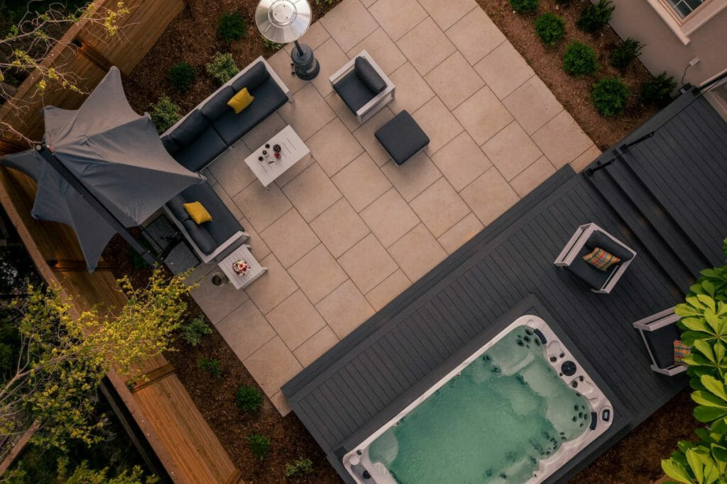 Toronto Landscaping Project; Featuring Stone Interlocking, Patio Design with PVC Decking, Glass Railings, Lighting, and Swim Spa by M.E. Contracting
