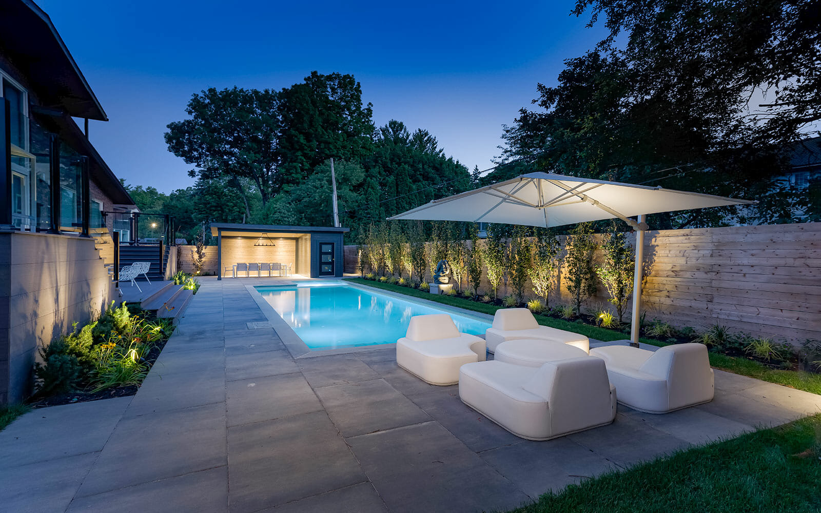 Complete Landscape Design with Concrete Pool Installation; Featuring Interlocking, Concrete Pool, Gazebo, PVC Decking & Privacy Fence by Toronto Landscaping Company.
