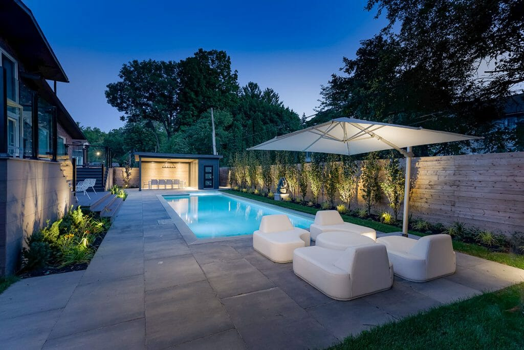 Toronto Landscaping Project on Pheasant Drive by M.E. Contracting; Featuring Concrete Pool Installation with Lighting Features, Privacy Fence, PVC Deck Build & Gazebo