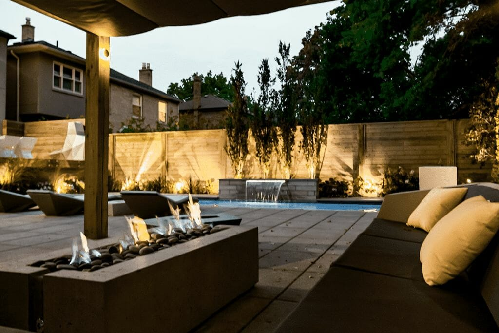 Toronto Landscaping Project with Fiberglass Pool Installation & Water Feature, Interlocking, Decking & Cedar Privacy Fence