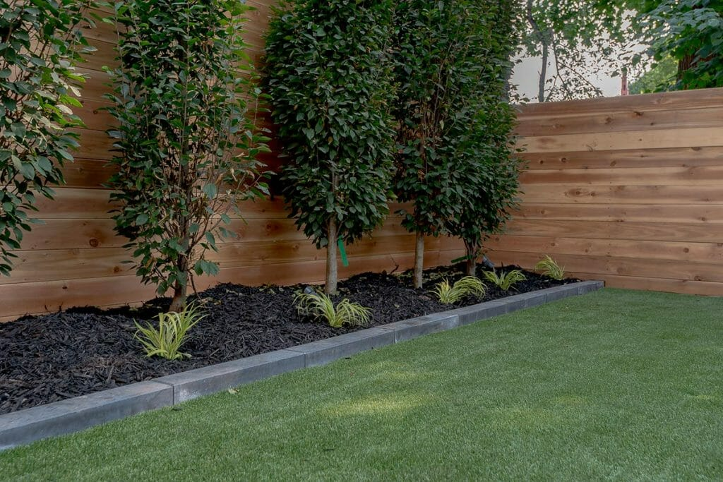 Toronto Patio Design Project; Featuring Small Retaining Wall, Soft Scape, Irrigation Sprinkler System & Cedar Privacy Fence Build