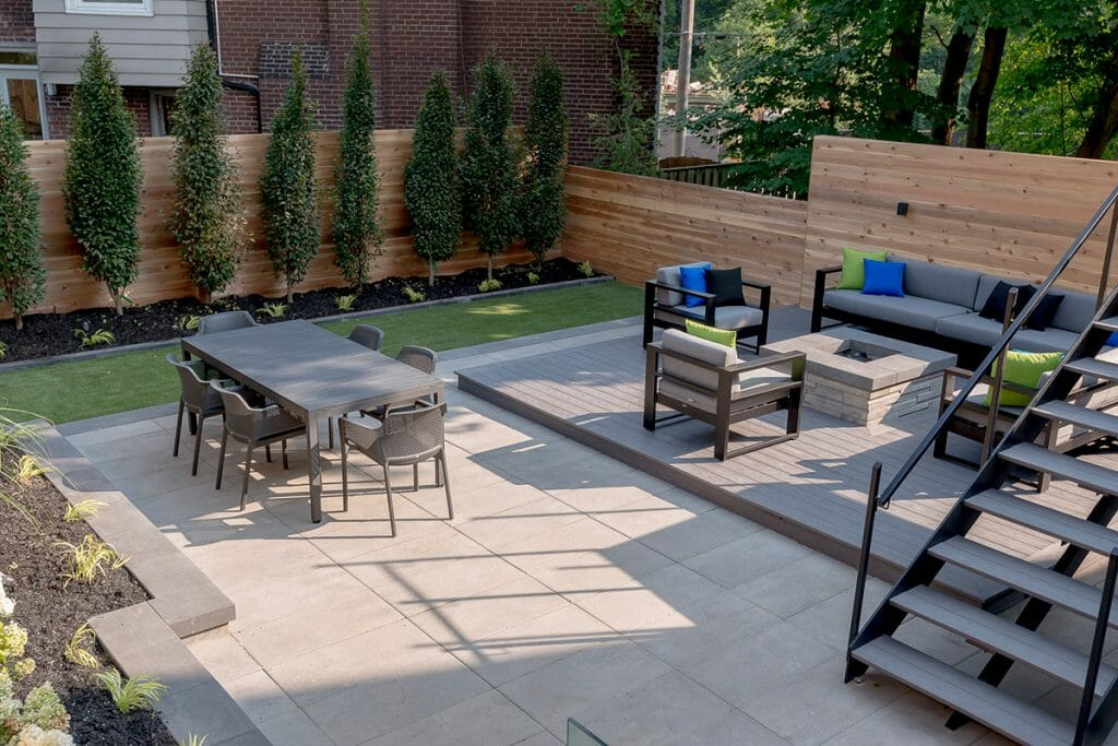 Toronto Patio Design Project with Small Retaining Wall, Cedar Privacy Fence, Outdoor Fireplace & Interlocking