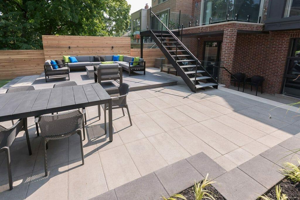 Toronto Patio Design Project with Wrought Iron Railings, Interlocking, Outdoor Fireplace & Toronto Deck Build