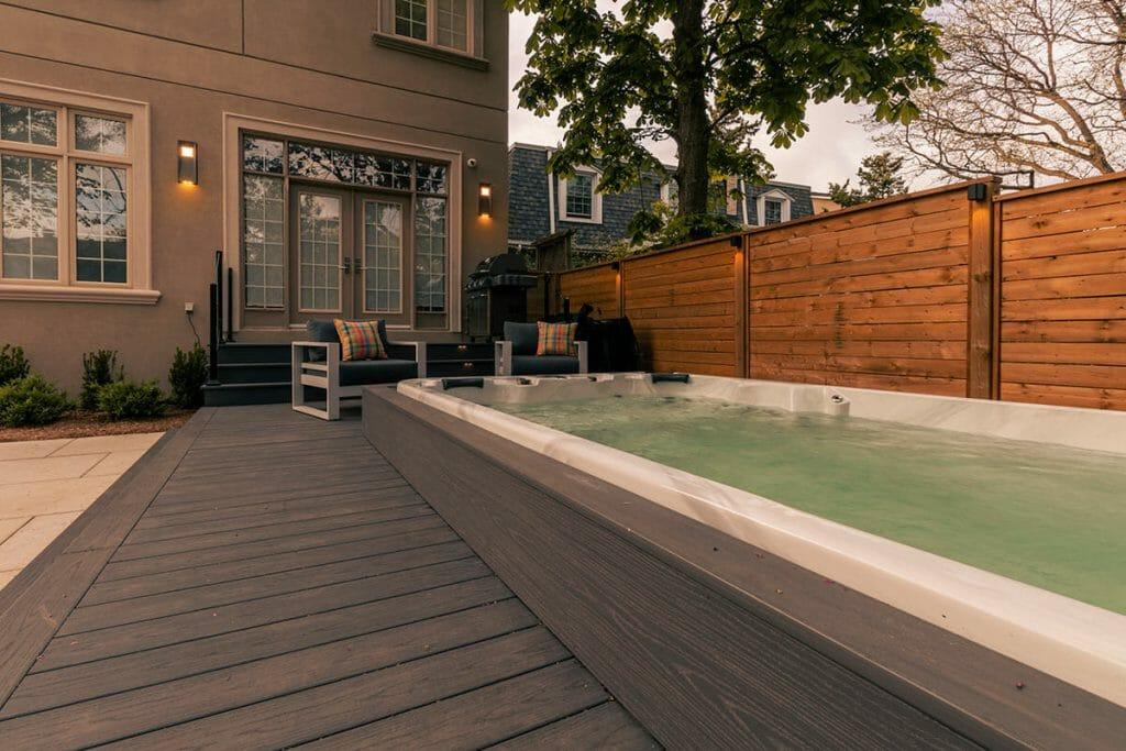 Toronto Premium Landscaping Project; Featuring Interlocking, PVC Decking, Patio Design, & Swim Spa Installation