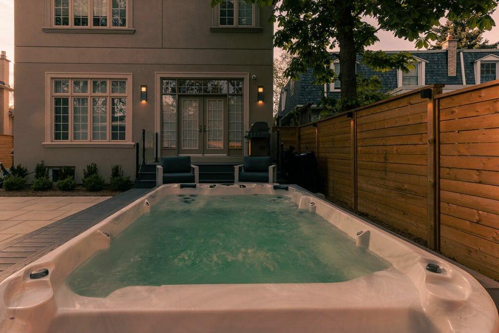 Toronto Premium Landscaping Project with PVC Decking, Interlocking, Patio Design & Swim Spa