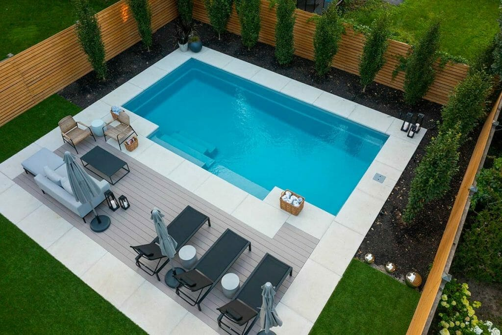 Total Backyard Landscaping Project by M.E. Contracting; Featuring Landscape Design, Pool Deck Interlocking, Fiberglass Pool Installation, PVC Decking & Softscape.