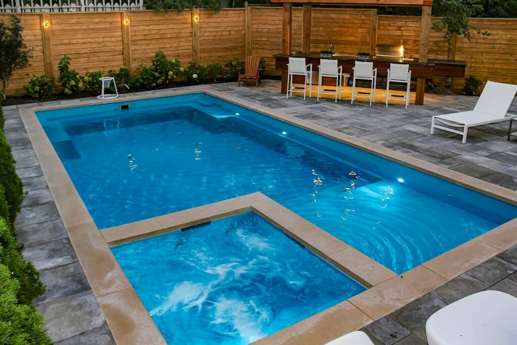 Total Landscape Design & Fiberglass Pool Installation Project with Woodworking and Interlocking by M.E. Contracting.