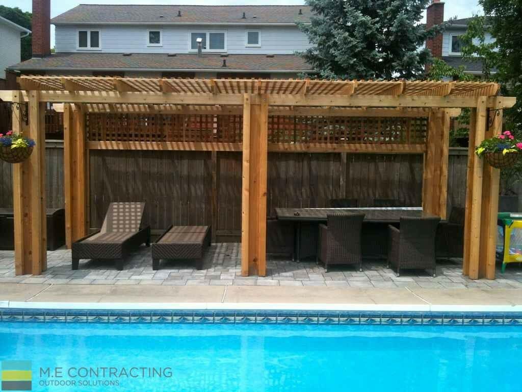 Fiberglass pool, interlocking, cedar pergola, outdoor patio